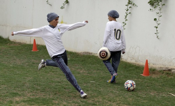 Members of a women's soccer team practice recently at a secret location in Riyadh, Saudi Arabia. IOC President Jacques Rogge is optimistic the Saudis may allow women to compete in the Olympics for the first time in London.