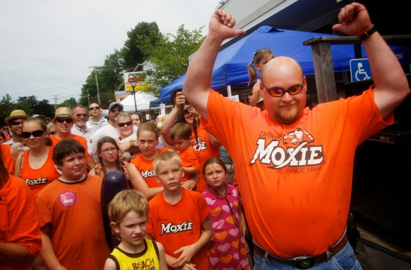 Winner and still champion, Beau Bradstreet matched his 2011 record of eight cans of Moxie at the annual Chugging Challenge at the Moxie Festival in Lisbon Falls Saturday, July 14, 2012.