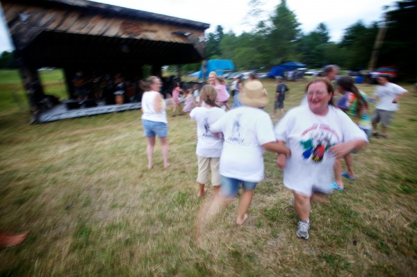 Revelers dance the afternoon away despite intermittent sprinkles of rain Sunday afternoon July 29, 2012 at the 40th annual East Benton Fiddlers Convention.