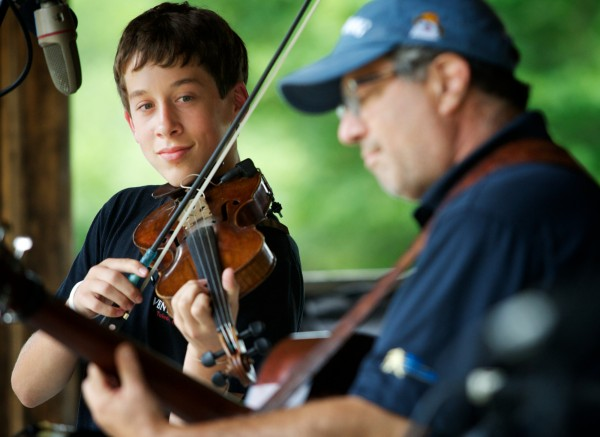 Max Silverstein, 15, of Bangor plays onstage with his father Jeff at the East Benton Fiddlers Convention July 29, 2012.