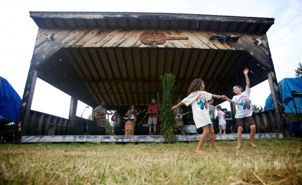 Hope Bouchard (left), 7, and Leah Couture, 10, dance during the final few minutes of the 40th annual East Benton Fiddlers Convention Sunday, July 29, 2012.