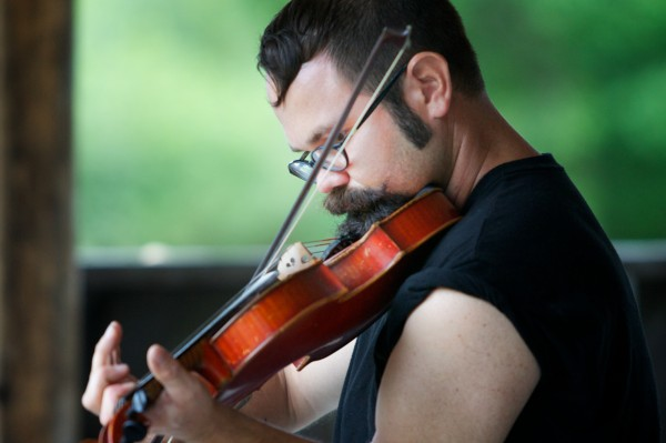 Cody McManus plays a tune while competing in the 40th annual East Benton Fiddlers Convention on his grandparents' farm Sunday July 29, 2012.