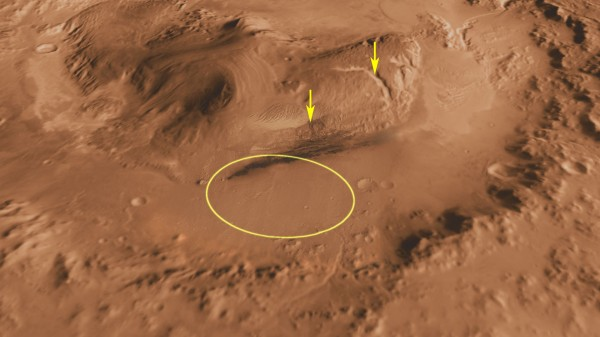 This view of Gale Crater on Mars shows the landing site that NASA's Mars Science Laboratory will investigate. Gale Crater is 96 miles in diameter and holds a layered mountain rising about 3 miles above the crater floor. The rock in the landing area may be an ancient playa lake deposit, where the mission will  check for the presence of organic molecules, since these environments may have been habitable — able to support microbial life. The arrows point to possible destinations for the Curiosity rover.