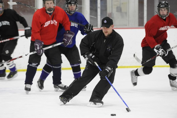 John Bapst Memorial High School assistant coach Matt Stairs (center) takes control of the puck during a team practice at Bangor's Sawyer Arena in 2009. Stairs, a former major league baseball player who has lived in Bangor for the last 12 years, is moving back to his native New Brunswick.