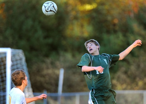 Audyn Curless (right) of Mount Desert Island heads the ball away from Bucksport's Chris St. Peter during a game last season. Curless, who will be a senior this season, will be coached by his dad, Michael Curless, who was recently named the school's boys soccer coach.