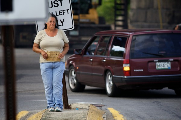 Kelly Noble panhandles in the median strip on the corner of St. John Street and Park Avenue in Portland on Tuesday July 3, 2012.