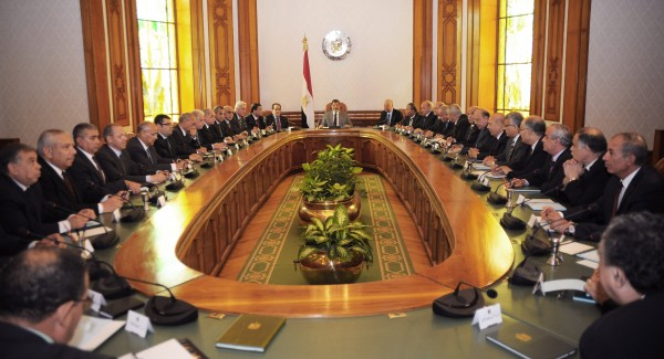 Newly elected President Mohammed Morsi (center) meets with government ministers at the presidential palace in Cairo, Egypt, Monday, July 2, 2012.
