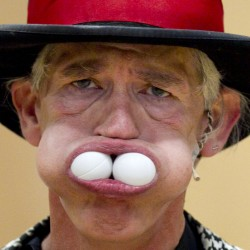 With cheeks that stretch like rubbber, Michael Trautman fits five ping-pong balls into his mouth.