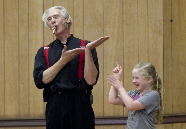 Trautman uses a kazoo, and a girl from the audience, during a skit about an imaginary mosquito.