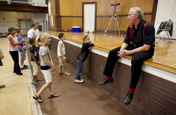 Trautman shares some of the secrets of his performance tricks with kids after a show in Lewiston.