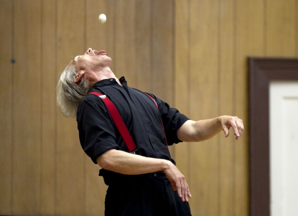 Trautman juggles a ping-pong ball with his mouth.