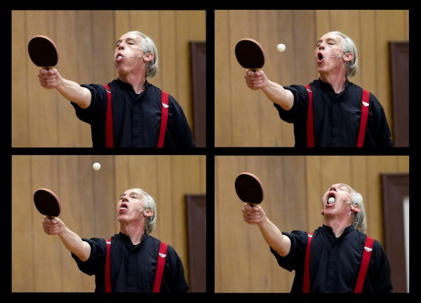 Trautman shoots a ping-pong ball off a paddle before catching it with his mouth.