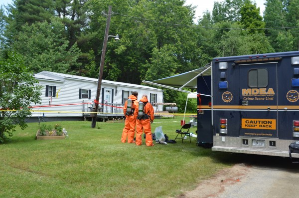 Drug officials raid a meth lab in Monmouth on Thursday, June 21, 2012.