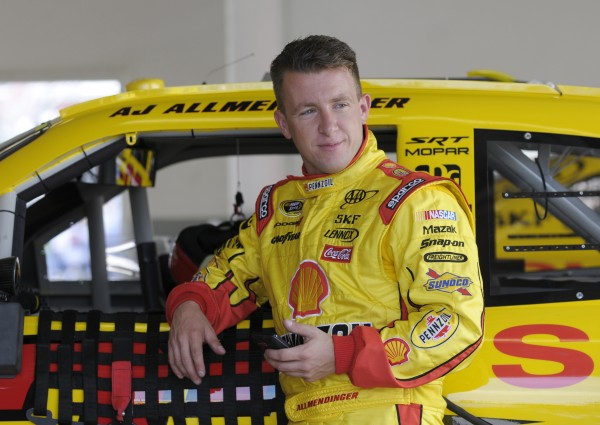 AJ Allmendinger leans against his car in the garage area during practice at Daytona International Speedway in Daytona Beach, Fla., earlier this year.
