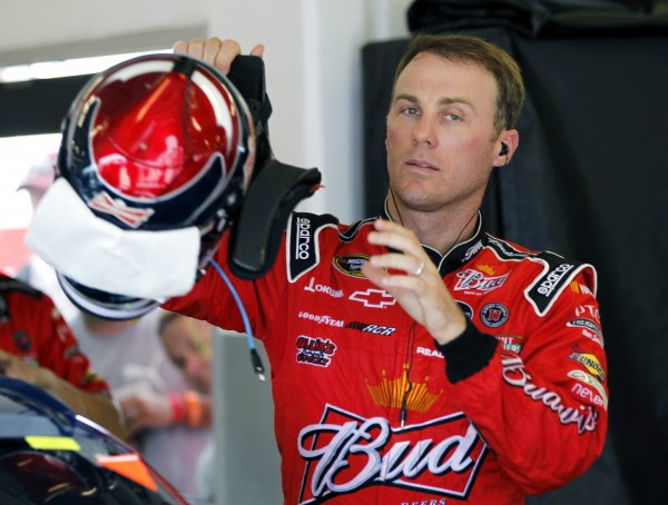 Kevin Harvick puts on his helmet during practice for the NASCAR Sprint Cup Series Coke Zero 400 auto race at Daytona International Speedway on Thursday, July 5, 2012, in Daytona Beach, Fla.