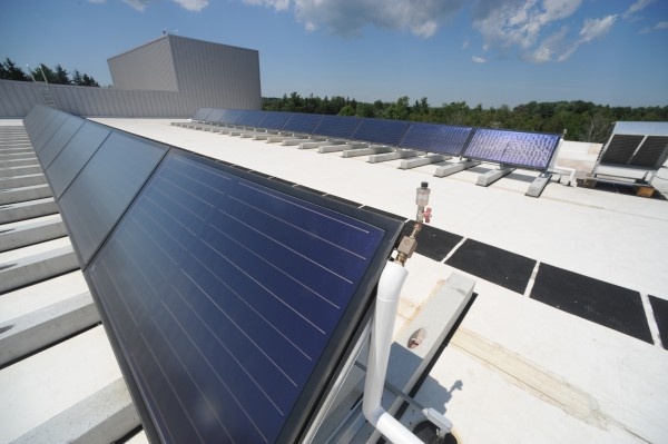 Rooftop solar panels (pictured) and geothermal energy will help heat the new Hampden Academy school complex, which will open this August.