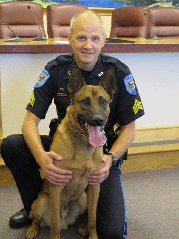 Sgt. Shawn Willey of the Ellsworth Police Department and his new partner, Chase, are shown Monday, July 9, 2012.