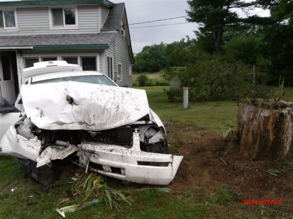 A white Ford Mustang crashed onto the property of Donna Conary at 1589 Acadia HIghway in Orland around 9 a.m. Tuesday, July 24, 2012.