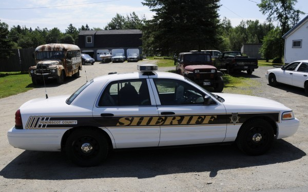 A Penobscot County Sheriff's Department vehicle is parked alongside the property at 310 Johnson Mill Road in Orrington on Sunday morning, July 22, 2012.