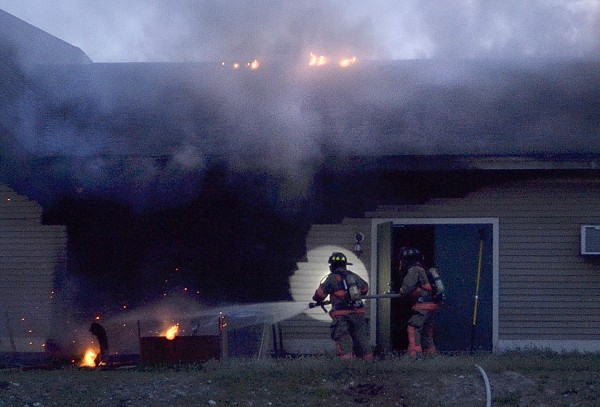 Firefighters respond to a structure fire on Main Street in Old Town on Tuesday evening, July 10, 2012.