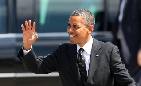 President Barack Obama waves upon his arrival, Tuesday, July 24, 2012, at the 142nd Fighter Wing Oregon Air National Guard Base, in Portland, Ore. Obama has arrived in Oregon to raise money for his re-election campaign.
