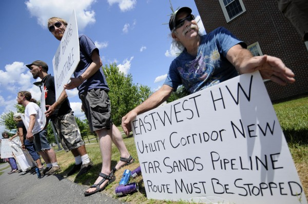 Jim Freeman (far right) of Verona Island and other members of Occupy Augusta held a demonstration in front of the Diamond Building on Colby's campus Saturday afternoon, July 21, 2012.