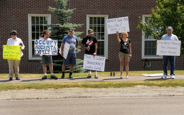 Members of Occupy Augusta held a demonstration in front of the Diamond Building on Colby's campus Saturday afternoon, July 21, 2012.