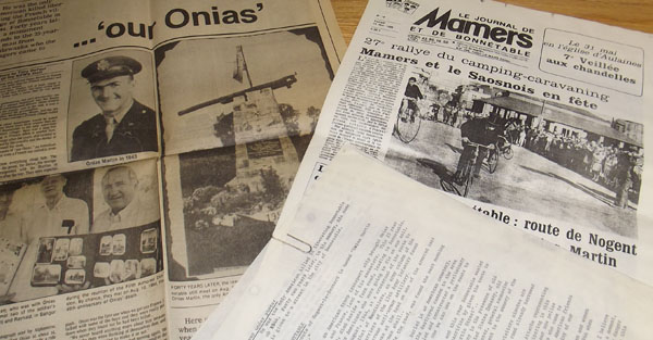 Newspaper clippings from 1980s issues of the Bangor Daily News and the Bonnetable-area newspaper about Onias Martin and his connection with Bonnetable, where he's celebrated as a liberator who returned to free his ancestral homeland during WWII, according to Frederic Gaignard, the Bonnetable resident who cares for a monument built in Bonnetable to honor Onias. Gaignard and his family are visiting Maine this week and are traveling to Madawaska to see the town Onias grew up in.