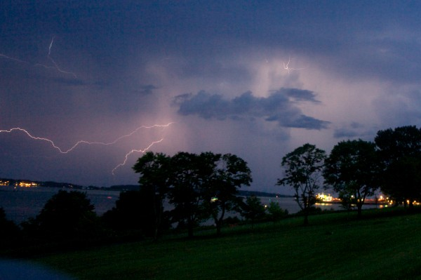 Lightning streaks across the sky above Portland harbor, lighting the grassy spaces of the Eastern Prom on Wednesday.