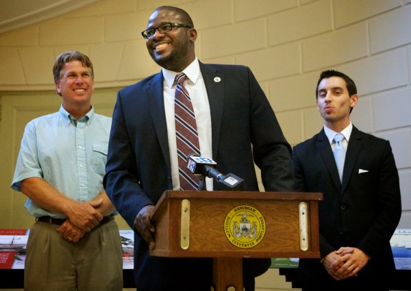 New Portland School Superintendent Emmanuel Caulk (center) flanked by Lyman Moore Middle School Principal Stephen Rogers (left) and school board member Justin Costa, speaks at a press conference after being confirmed by the board Monday night July 9, 2012. Caulk is scheduled to start in August.