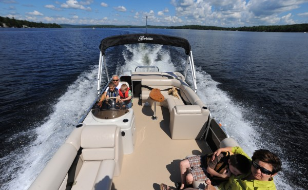 The Dunn family rides on their pontoon boat on Beech Hill Pond in Otis in July 2012. The popularity of these boats have increased in recent years. Jim and Joan Dunn said that they use the boat for a variety of things from breakfast on the lake to fishing or swimming with their kids.