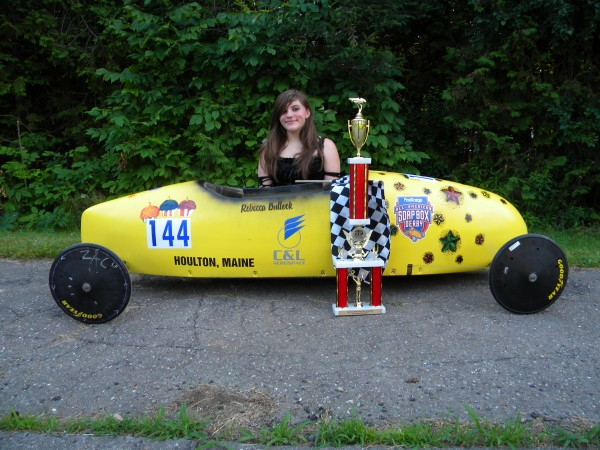 Rebecca Bullock of Hampden shows off her championship trophy after winning at a state soap box derby competition in Houlton in June. She advanced to the national competition July 16-21 in Akron, Ohio.