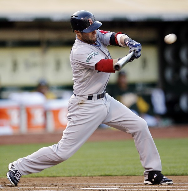Dustin Pedroia of the Boston Red Sox connects for an RBI single off Oakland Athletics' Jarrod Parker on Monday, July 2, 2012, in San Francisco.