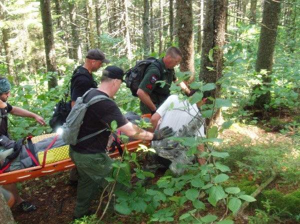 Rescue Personnel prepare to carry out a 16-year-old Wisconsin girl who injured her ankle while hiking the Appalachian Trail.