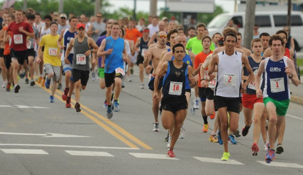 Runners take to Wilson Street in Brewer for the start of the 2012 Walter Hunt 3K on Wednesday,.
