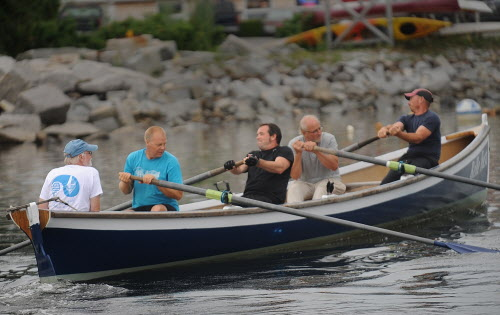 Members of the Come Boating! crew row their 32-foot Cornish pilot gig in Belfast's harbor Thursday evening, July 26, 2012. From left are coxswain Rick Fitzsimmons of Belfast, Jonathan Fulford of Monroe, Ethan Shaw of Belfast, Greg Stafford of Monroe and Aaron Bauman of Belfast.
