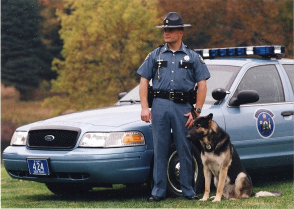 The well-loved Maine State Police K-9 Ruger, pictured with Maine State Trooper Stephen Hills, recently died.