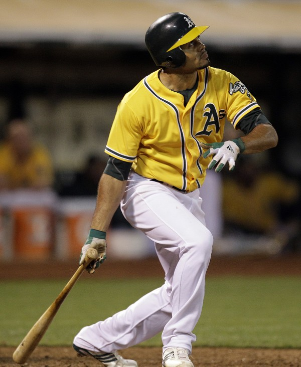 Oakland Athletics' Coco Crisp watches his game-winning sacrifice fly hit off Boston Red Sox's Alfredo Aceves in the ninth inning of a baseball game Tuesday, July 3, 2012, in Oakland, Calif.