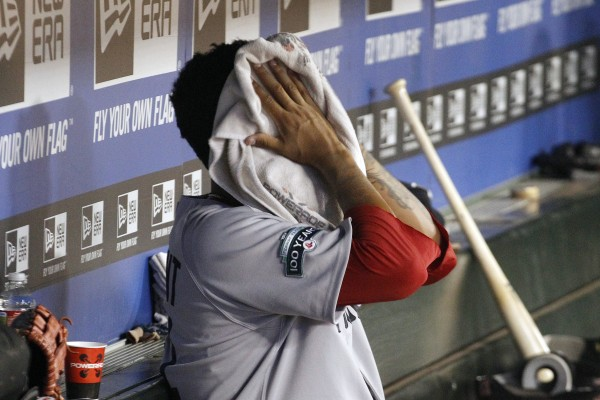 Boston Red Sox starting pitcher Felix Doubront puts a towel on his face in the dugout after he was pulled during the sixth inning of a baseball game against the Texas Rangers, Monday, July 23, 2012, in Arlington, Texas. The Rangers won 9-1.