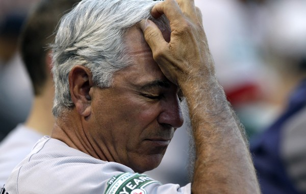 Boston Red Sox manager Bobby Valentine reacts in the dugout during a baseball game against the Texas Rangers, Wednesday, July 25, 2012, in Arlington, Texas. The Rangers won 5-3.