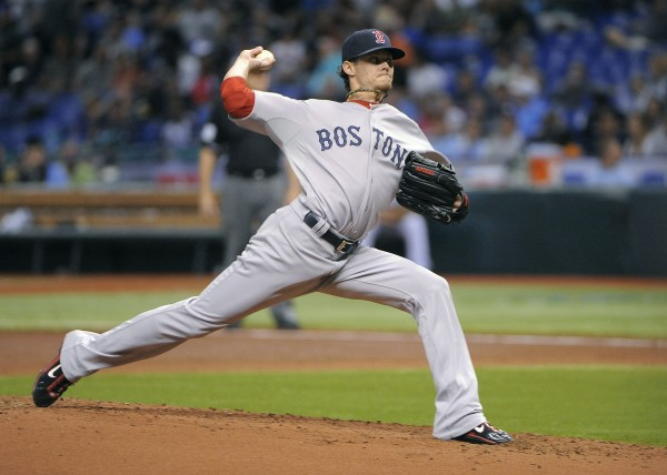 Boston Red Sox starting pitcher Clay Buchholz delivers to the Tampa Bay Rays during the first inning of a baseball game Saturday, July 14, 2012, in St. Petersburg, Fla. The Rays won 5-3.