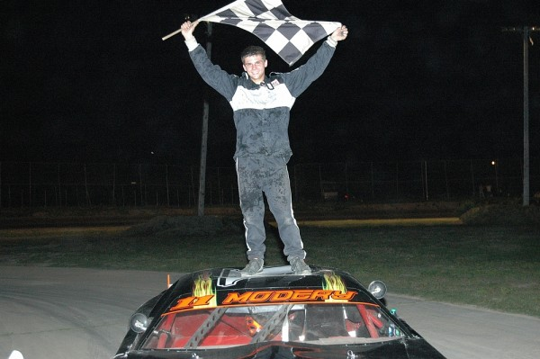 Ryan Modery, 17, of Hermon celebrates after winning a Late Model race at Speedway 95 on Saturday, July 7, 2012.