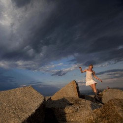 A girl scrambles on the rocks of the Camp Ellis jetty as the late day sun breaks through the clouds Sunday, July 1, 2012, in Saco.