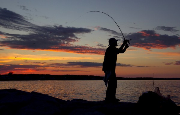 Irvin Serrano, of Biddeford, casts for marckerel at sunset from the Camp Ellis jetty Sunday, July 1, 2012, in Saco.