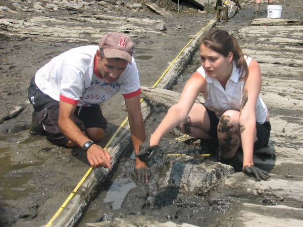 Marine archaeologist Franklin Price and College of the Atlantic student Christa Shere discuss the layout of an old ship's keel at a wreck site on MDI on Saturday, July 14, 2012.