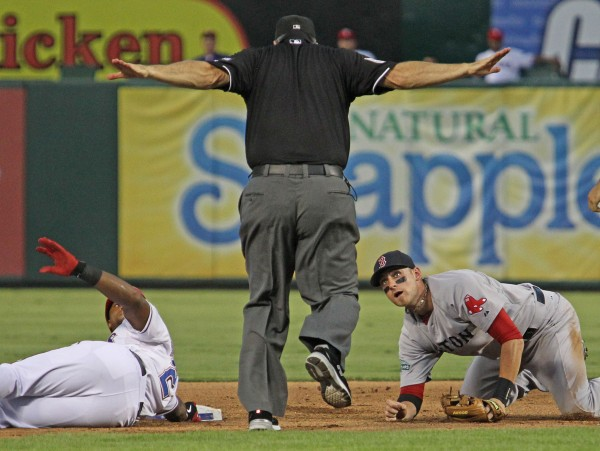 Boston Red Sox third baseman Will Middlebrooks (64) looks up at second base umpire Jeff Nelson after Texas Rangers third baseman Adrian Beltre's (29) double in the bottom of the fourth inning on Tuesday  night, July 24, 2012, Arlington, Texas. Nelson calls Beltre safe at second.