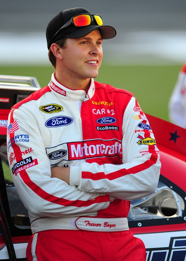 NASCAR Sprint Cup Series driver Trevor Bayne stands next to his car before his qualifying run for the Coca-Cola 600 in May at Charlotte (N.C) Motor Speedway. Bayne will be competing in the TD Bank 250 at Oxford Plains Speedway on July 22.