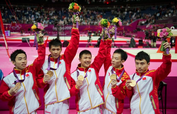 The men's gymnastics team from China celebrated their gold medal victory in team finals at North Greenwich Arena during the 2012 Summer Olympic Games in London, England, Monday, July 30, 2012.