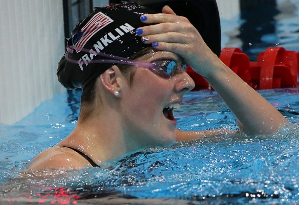 USA's Missy Franklin reacts after winning the women's 100m backstroke final at the Summer Olympics in London, England, Monday, July 30, 2012.