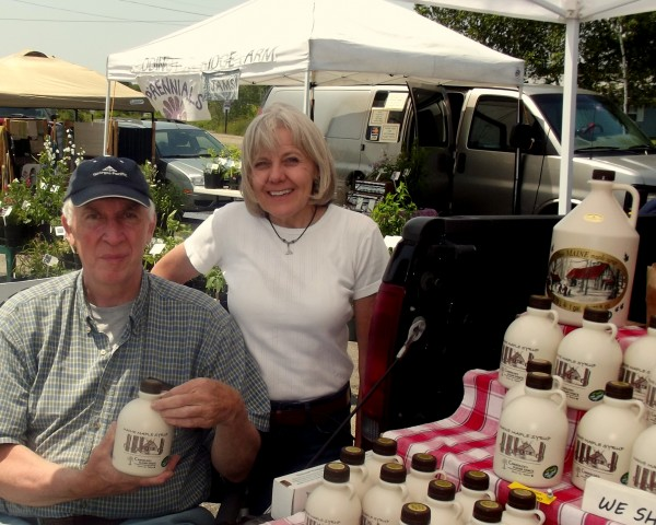 Bob and Margie Chandler sell maple syrup from their Chandler's Sugar Shack in Topsfield at the causeway farmers market in Machias. The couple maintains 2,000 taps and their business is one of the largest maple syrup producers in Washington County.